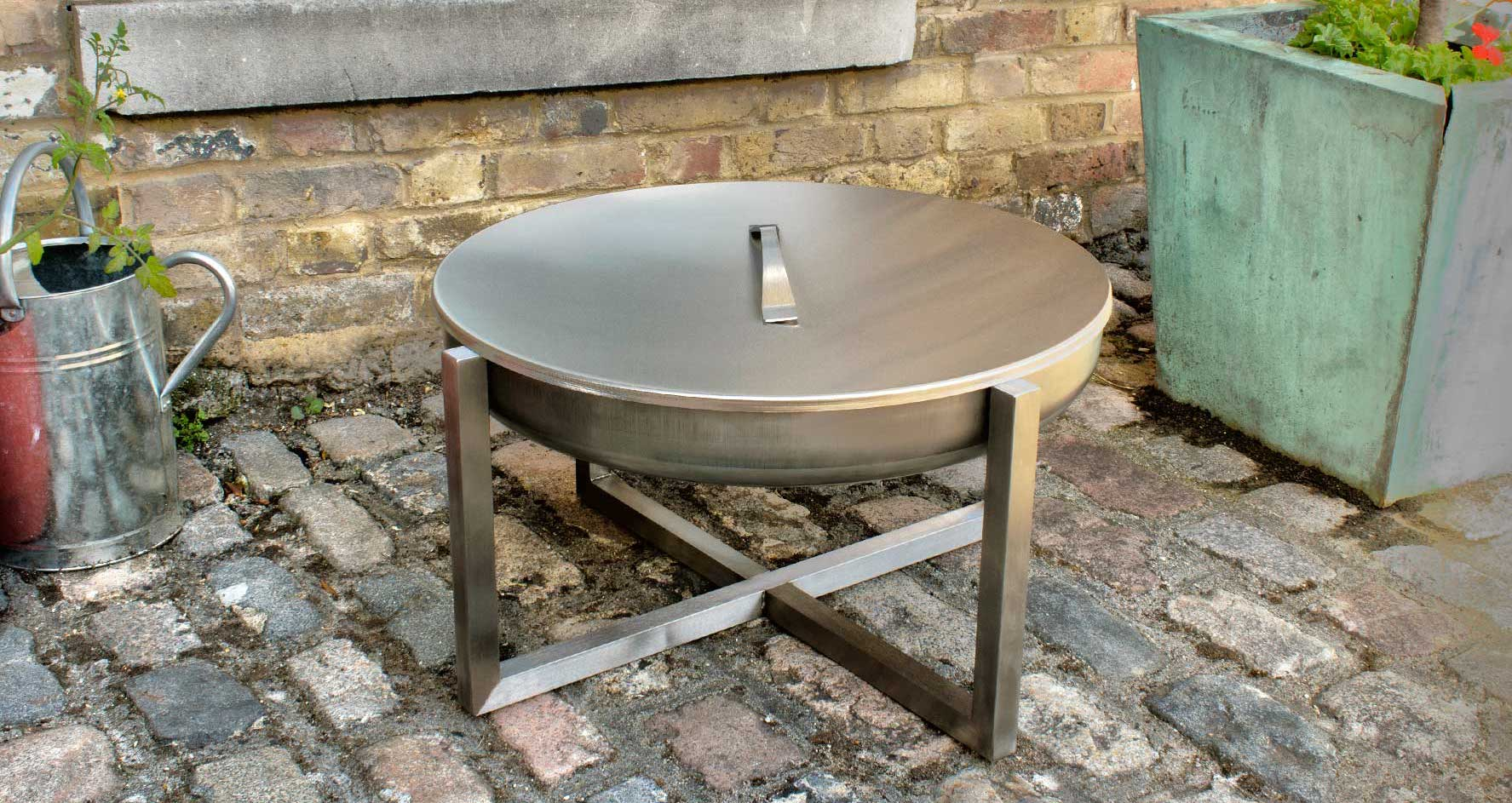 covered stainless Quadra fire pit