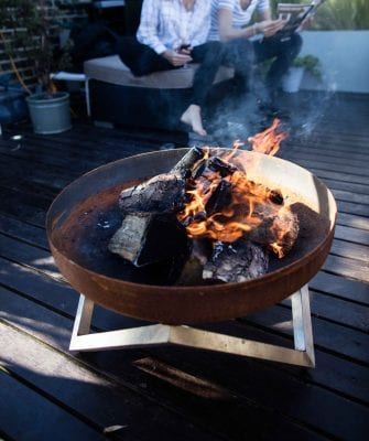 Summer afternoon at the terrace around Yanartas fire pit (rusting bow, stainless steel legs)